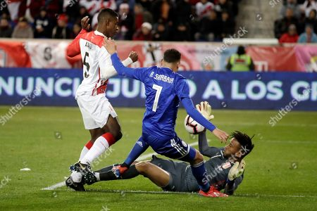 Peru goalkeeper Pedro Gallese, right, makes a save as Paraguay's Antonio Sanabria, center, attacks during the first half of an international soccer friendly match, in Harrison, N.J. Peru's Miguel Araujo, left, helps defend on the play