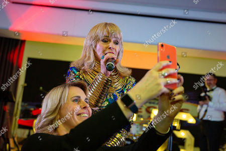 Stock Photo of Toyah Willcox doing a selfie with guests.