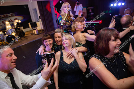 Toyah Willcox doing a selfie with guests.