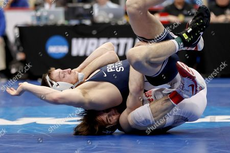 Nick Lee, Joey McKenna. Ohio State's Joey McKenna, bottom, pulls Penn State's Nick Lee over him during their 141-pound match in the semifinals of the NCAA wrestling championships, in Pittsburgh. McKenna won and will face Cornell's Yianni Diakomihalis in the finals Saturday