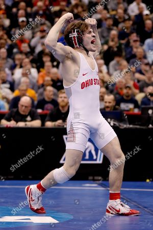 Ohio State's Joey McKenna, celebrates after defeating Penn State's Nick Lee in their 141-pound match in the semifinals of the NCAA wrestling championships, in Pittsburgh. McKenna will face Cornell's Yianni Diakomihalis in the finals Saturday