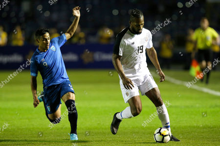 Costa Rica's Kendall Waston, right, dribbles the ball past Guatemala's Luis Martinez during a friendly soccer match at Mateo Flores stadium in Guatemala City