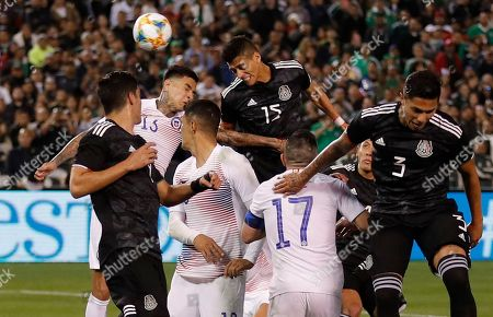 Mexico's Hector Moreno, above right, heads the ball in for a goal during the second half of an international friendly soccer match against Chile, in San Diego