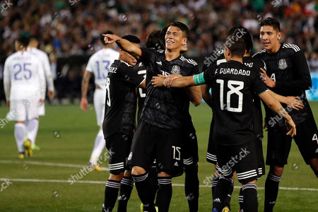 Mexico's Hector Moreno, center, celebrates with teammates after scoring a goal during the second half of an international friendly soccer match against Chile, in San Diego