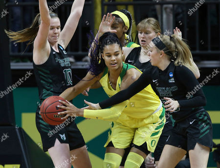 Stock Photo of Oregon's Satou Sabally, center, is defended by Portland State's Courtney West, left, Desirae Hansen and Kylie Jimenez, right, with Oregon's Ruthy Hebard behind during the first half a first-round game of the NCAA women's college basketball tournament, in Eugene, Ore