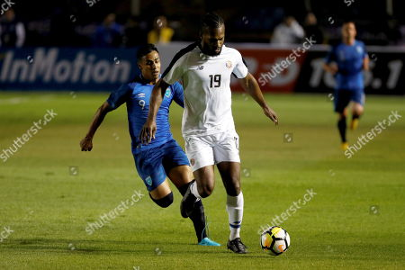 Costa Rica's Francisco Calvo (L) vies for the ball against Luis Martinez (L) of Guatemala during a friendly match between Guatemala and Costa Rica at the Doroteo Guamuch stadium in Guatemala City, Guatemala, 22 March 2019.