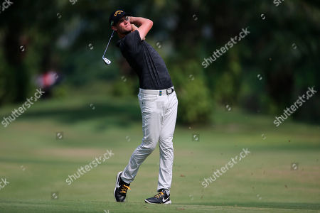 Thomas Pieters of Belgium plays his shot at 8th hole during the Malaysia Golf Championship 3rd round in Kuala Lumpur, Malaysia