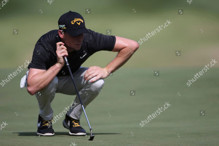 Thomas Pieters of Belgium looking at his putt line on the 9th hole at the Malaysia Golf Championship 3rd round in Kuala Lumpur, Malaysia