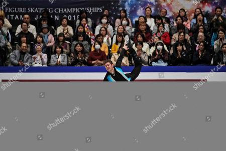 Jason Brown from the U.S. performs his men's free skating routine during the ISU World Figure Skating Championships at Saitama Super Arena in Saitama, north of Tokyo