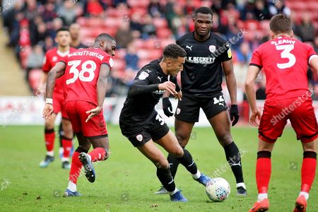 Goalscorer Barnsley forward Jacob Brown (33) is heavily marked during the EFL Sky Bet League 1 match between Walsall and Barnsley at the Banks's Stadium, Walsall