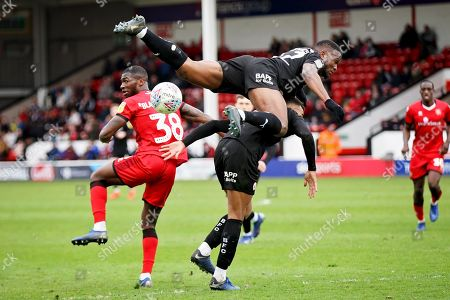Barnsley defender Dimitri Cavare (12) and Barnsley forward Jacob Brown (33) get tangled up during the EFL Sky Bet League 1 match between Walsall and Barnsley at the Banks's Stadium, Walsall