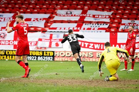 Barnsley forward Jacob Brown (33) runs away celebrating after scoring the winning goal in time added on during the EFL Sky Bet League 1 match between Walsall and Barnsley at the Banks's Stadium, Walsall