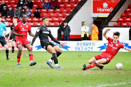 Barnsley forward Jacob Brown (33) scores the winning goal in time added on during the EFL Sky Bet League 1 match between Walsall and Barnsley at the Banks's Stadium, Walsall
