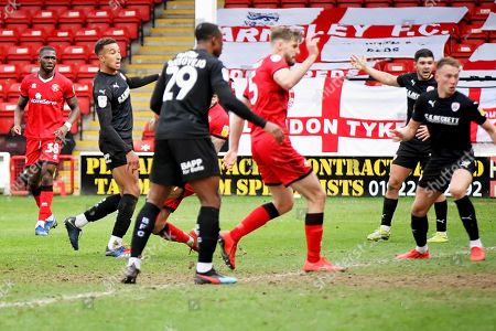 Barnsley forward Jacob Brown (33) looks to see his shot go in the back of the net in time added on during the EFL Sky Bet League 1 match between Walsall and Barnsley at the Banks's Stadium, Walsall