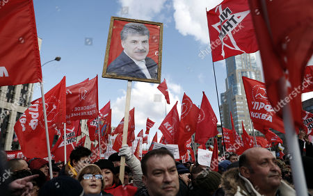 Russian communists hold a portrait of Russian businessman and former presidential candidate from the Communist party of Russian Federation Pavel Grudinin during anti-government rally in Moscow, Russia, 23 March 2019. Participants of the rally demand to change the social economic course of the development of Russia.