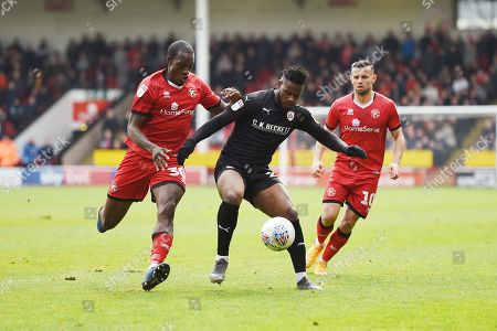 Mamadou Thiam of Barnsley is challenged by Isaiah Osbourne of Walsall.