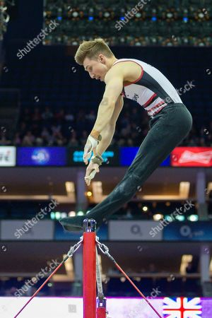 Sam Oldham of Great Britain on the horizontal bar  during the The Superstars of Gymnastics event at the O2 Arena, London