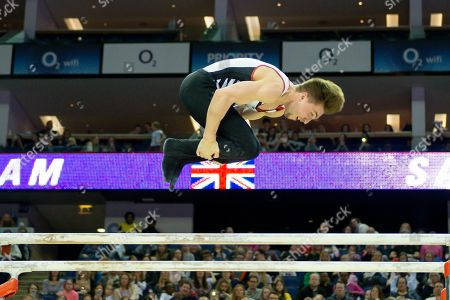Stock Photo of Sam Oldham of Great Britain on the Parallel bars during the The Superstars of Gymnastics event at the O2 Arena, London