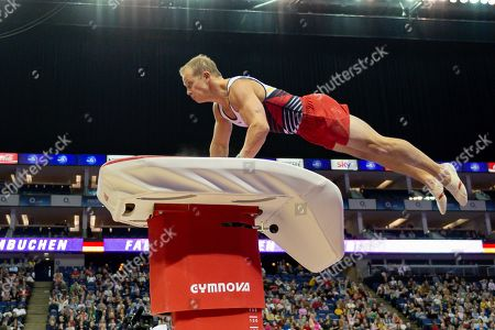 Stock Image of Fabian Hambuchen of Germany does the 'superman' off of the vault during the The Superstars of Gymnastics event at the O2 Arena, London