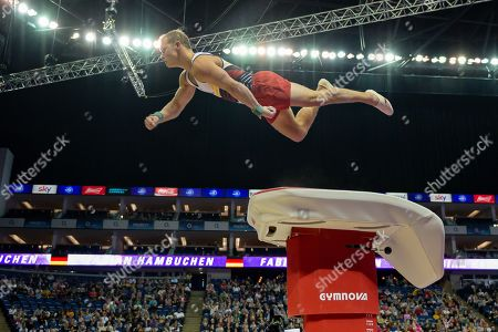 Stock Photo of Fabian Hambuchen of Germany does the 'superman' off of the vault during the The Superstars of Gymnastics event at the O2 Arena, London