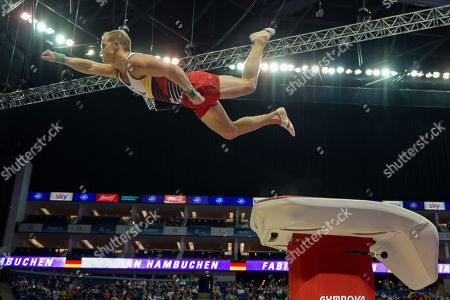 Fabian Hambuchen of Germany does the 'superman' off of the vault during the The Superstars of Gymnastics event at the O2 Arena, London