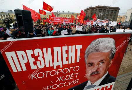 Russian communist party members carry a banner 'Pavel Grudinin - President Russia is waiting for' as they attend a communist rally in central St. Petersburg, Russia, 23 March 2019. Participants marched in defense of social and economic rights of citizens.