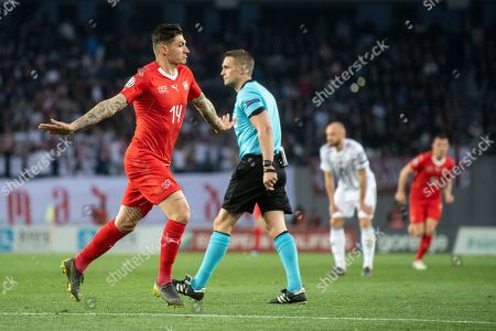Switzerland's Steven Zuber (L) celebrates his goal during the UEFA Euro 2020 qualifier Group D soccer match between Georgia and Switzerland at the Boris Paichadze National Stadium in Tbilisi, Georgia, 23 March 2019.
