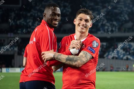 Switzerland's Yvon Mvogo (L) and Steven Zuber (R) react after the UEFA Euro 2020 qualifier Group D soccer match between Georgia and Switzerland at the Boris Paichadze National Stadium in Tbilisi, Georgia, 23 March 2019.