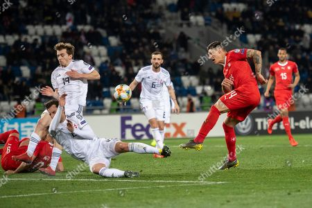 Georgia's Saba Lobjanidze (L) in action against Switzerland's Steven Zuber (R) during the UEFA Euro 2020 qualifier Group D soccer match between Georgia and Switzerland at the Boris Paichadze National Stadium in Tbilisi, Georgia, 23 March 2019.