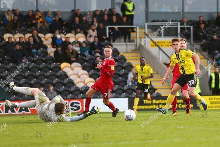 Burton Albion midfielder Ben Fox (12) shoots during the EFL Sky Bet League 1 match between Burton Albion and Accrington Stanley at the Pirelli Stadium, Burton upon Trent