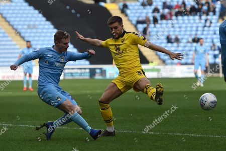 Coventry City midfielder (on loan from Derby County Luke Thomas (23) gets in a cross under pressure from Oxford United defender 9on loan from Everton) Luke Garbutt (3) during the EFL Sky Bet League 1 match between Coventry City and Oxford United at the Ricoh Arena, Coventry
