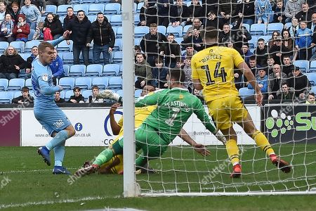 Oxford United goalkeeper Simon Eastwood (1) makes an important save  from Coventry City midfielder (on loan from Derby County Luke Thomas (23) during the EFL Sky Bet League 1 match between Coventry City and Oxford United at the Ricoh Arena, Coventry