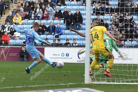Coventry City midfielder (on loan from Derby County Luke Thomas (23) takes a shot at goal during the EFL Sky Bet League 1 match between Coventry City and Oxford United at the Ricoh Arena, Coventry