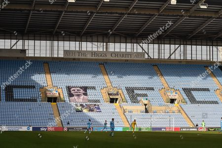 The Sun shines on a picture of Jimmy Hill in the stand during the EFL Sky Bet League 1 match between Coventry City and Oxford United at the Ricoh Arena, Coventry