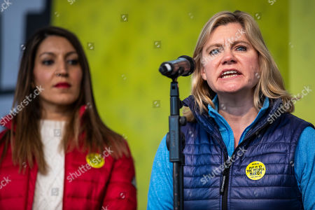 """Former Cabinet Minister Justine Greening (R) speaks in Parliament Square after an estimated one million people marched through central London to demand that government allow a """"People's Vote"""" on the Brexit deal. Several key votes will be held in Parliament in the coming week."""