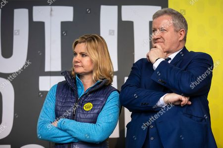"""Former Cabinet Minister Justine Greening (L) and SNO Westminster Leader Ian Blackford (R) on stage in Parliament Square after an estimated one million people marched through central London to demand that government allow a """"People's Vote"""" on the Brexit deal. Several key votes will be held in Parliament in the coming week."""