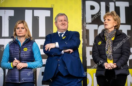"""Justine Greening (L), Ian Blackford (C) and Anna Soubry (R) on stage in Parliament Square after an estimated one million people marched through central London to demand that government allow a """"People's Vote"""" on the Brexit deal. Several key votes will be held in Parliament in the coming week."""