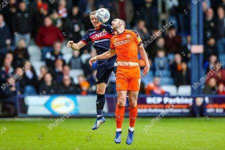 Doncaster Rovers defender Aaron Lewis (44) and Luton Town forward Danny Hylton (9) clash in the air during the EFL Sky Bet League 1 match between Luton Town and Doncaster Rovers at Kenilworth Road, Luton