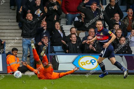 Doncaster Rovers defender Aaron Lewis (44) receives a yellow card for his tackle on Luton Town forward Kazenga LuaLua (25) during the EFL Sky Bet League 1 match between Luton Town and Doncaster Rovers at Kenilworth Road, Luton