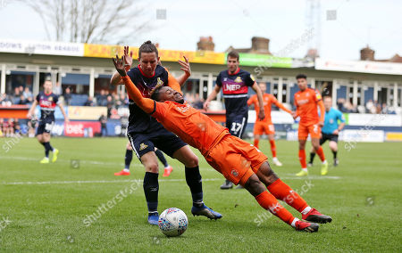 Kazenga Lua Lua of Luton Town is fouled by  Aaron Lewis of Doncaster