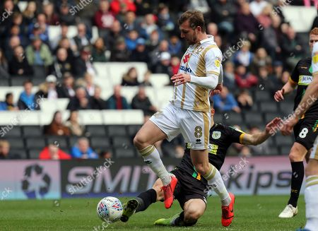Alex Gilbey of MK Dons and Gary Warren of Yeovil Town during MK Dons vs Yeovil Town, Sky Bet EFL League 2 Football at stadium:mk on 23rd March 2019
