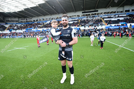 Scott Baldwin of Ospreys leads out his side.