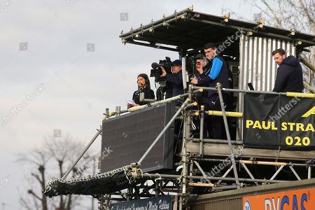 Stock Photo of Sky Sports reporter, Bianca Westwood, (far left) watches on from the TV Gantry during AFC Wimbledon vs Gillingham, Sky Bet EFL League 1 Football at the Cherry Red Records Stadium on 23rd March 2019