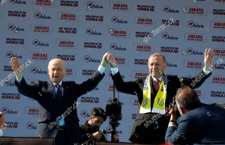 Recep Tayyip Erdogan, Devlet Bahceli. Turkey's President Recep Tayyip Erdogan, right, and Devlet Bahceli, left, the leader of opposition Nationalist Movement Party, MHP, salute the supporters of MHP and ruling Justice and Development Party, AKP, during a joint rally in Ankara, Turkey, . Erdogan's AKP and MHP made an alliance for the countrywide local elections scheduled for March 31, 2019 with 57 million registered voters