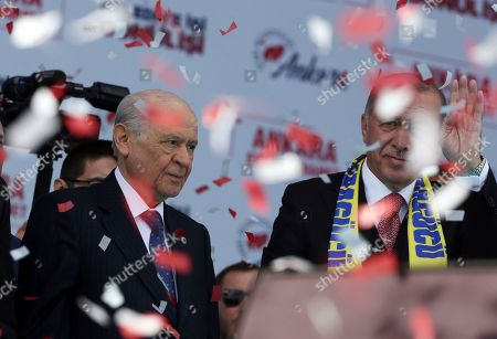 Recep Tayyip Erdogan, Devlet Bahceli. Turkey's President Recep Tayyip Erdogan, right, and Devlet Bahceli, the leader of opposition Nationalist Movement Party, MHP, waves to the supporters of MHP and ruling Justice and Development Party, AKP, during a joint rally in Ankara, Turkey, . Erdogan's AKP and MHP made an alliance for the countrywide local elections scheduled for March 31, 2019 with 57 million registered voters