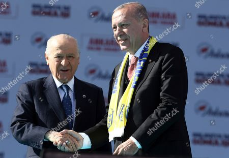 Recep Tayyip Erdogan, Devlet Bahceli. Turkey's President Recep Tayyip Erdogan, right, and Devlet Bahceli, the leader of opposition Nationalist Movement Party, MHP, salute the supporters of MHP and ruling Justice and Development Party, AKP, during a joint rally in Ankara, Turkey, . Erdogan's AKP and MHP made an alliance for the countrywide local elections scheduled for March 31, 2019 with 57 million registered voters