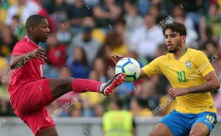 Brazil's Lucas Paqueta vies for the ball with Panama's Armando Cooper, left, during the friendly soccer match between Brazil and Panama at the Dragao stadium in Porto, Portugal
