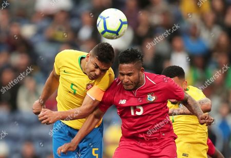 Brazil's Casemiro, left, jumps for the ball with Panama's Eric Davis during the friendly soccer match between Brazil and Panama at the Dragao stadium in Porto, Portugal