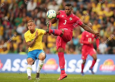 Panama's Harold Cummings clears the ball away from Brazil's Everton, left, during the friendly soccer match between Brazil and Panama at the Dragao stadium in Porto, Portugal