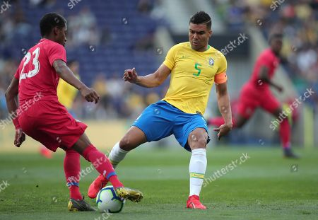 Brazil's Casemiro vies for the ball with Panama's Michael Amir Murillo, left, during the friendly soccer match between Brazil and Panama at the Dragao stadium in Porto, Portugal